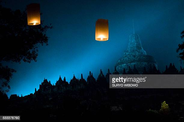 This picture taken on May 21 2016 shows lanterns floating over the Borobudur temple in Magelang Central Java during Vesak Day celebrations Indonesian...