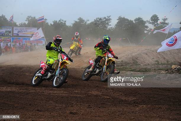 This picture taken on May 22 2016 shows motorbike riders competing in a motocross race at a racecourse in Thailand's southern province of Narathiwat...