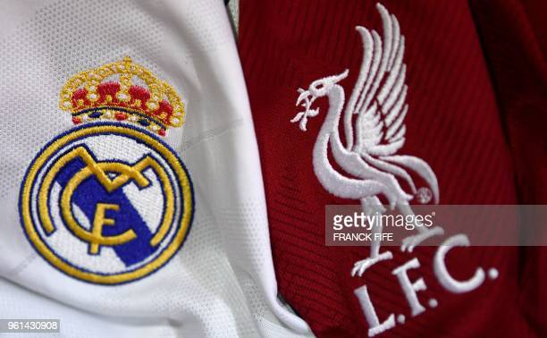 TOPSHOT This picture taken on May 22 2018 in Paris shows the logos on jerseys of Real Madrid and Liverpool FC Real Madrid CF and Liverpool FC will...