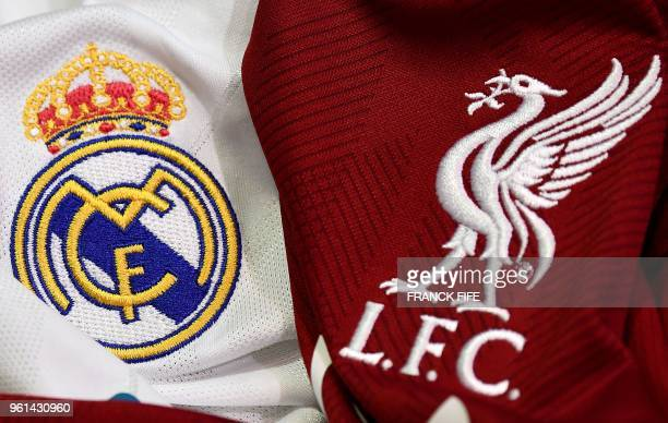 This picture taken on May 22 2018 in Paris shows the logos on jerseys of Real Madrid and Liverpool FC Real Madrid CF and Liverpool FC will play the...