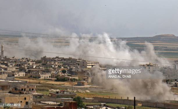 This picture taken on May 22 2019 shows smoke plumes rising following reported Syrian government forces' bombardment on the town of Khan Sheikhun in...