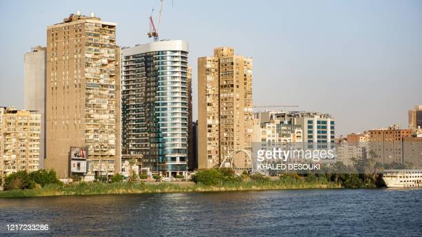 This picture taken on May 22, 2020 shows a view of apartment buildings whose facades are covered with split-type air conditioning units in the...