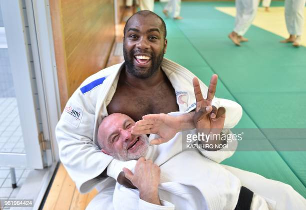 TOPSHOT This picture taken on May 23 2018 shows French judoka Teddy Riner posing with a judoka during his training at a dojo in the Tokyo suburb of...