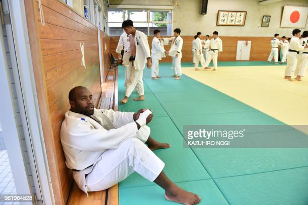 This picture taken on May 23 2018 shows French judoka Teddy Riner attending a training session with other judokas at a dojo in the Tokyo suburb of...