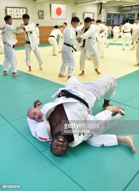 This picture taken on May 23 2018 shows French judoka Teddy Riner warming up during his training with other judokas at a dojo in the Tokyo suburb of...
