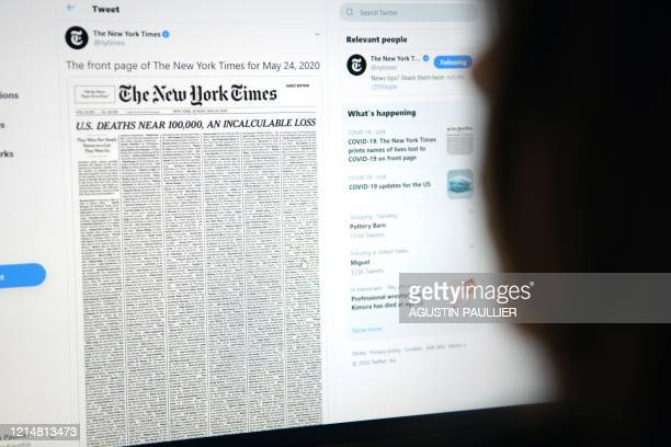 This picture taken on May 23 in Los Angeles California shows a woman looking at a computer screen with a tweet by the New York Times newspaper...