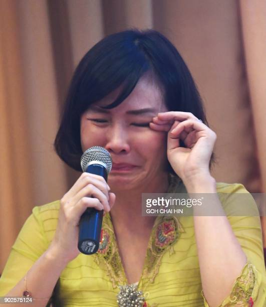 This picture taken on May 23 shows Veronica Tan the wife of former Jakarta Governor Basuki Tjahaja Purnama known as 'Ahok' breaking down as she reads...