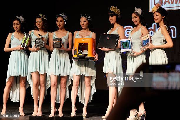 This picture taken on May 24 2016 shows models displaying the latest information technology products during the Best Choice Awards in Taipei ahead of...