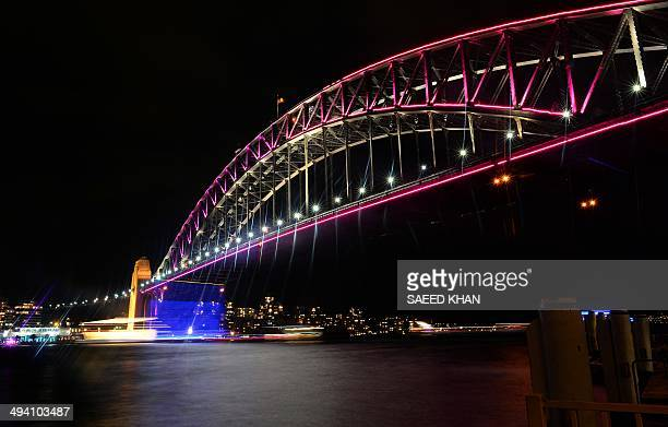 This picture taken on May 27 2014 shows the Sydney harbour bridge during the 'Vivid' light show in Sydney 'Vivid' is a major outdoor cultural event...