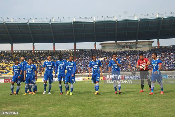 This picture taken on May 27 2015 shows Indonesian players of local side Persib Bandung walking on the pitch prior to their match against Hong Kong...