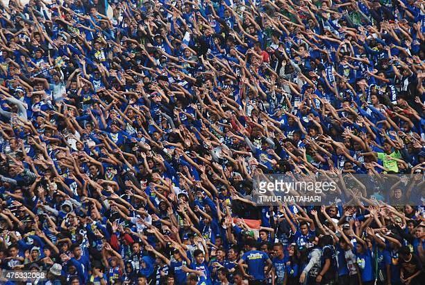 This picture taken on May 27 2015 shows Indonesian supporters of local club Persib Bandung waving during their match against Hong Kong club Kitchee...
