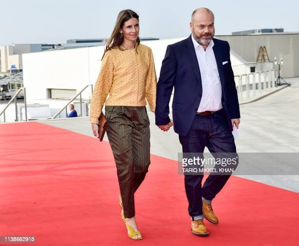This picture taken on May 27 2018 shows Bestsellerowner Anders Holch Povlsen and his wife Anne Holch Povlsen as they arrive at the celebration of the...