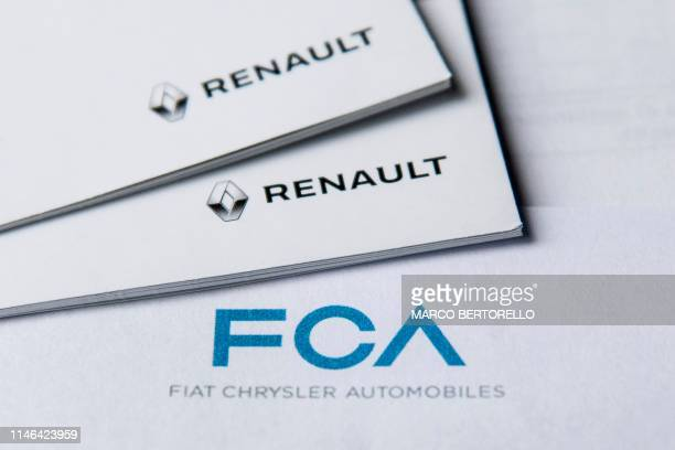 This picture taken on May 27 2019 in Turin shows the logos of ItalianUS carmaker Fiat Chrysler Automobiles and French auto maker Renault French and...