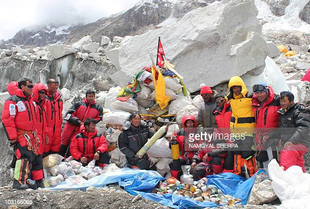 This picture taken on May 28 2010 shows Nepalese sherpa climbers posing after collecting garbage from the Everest cleanup expedition at Everest Base...
