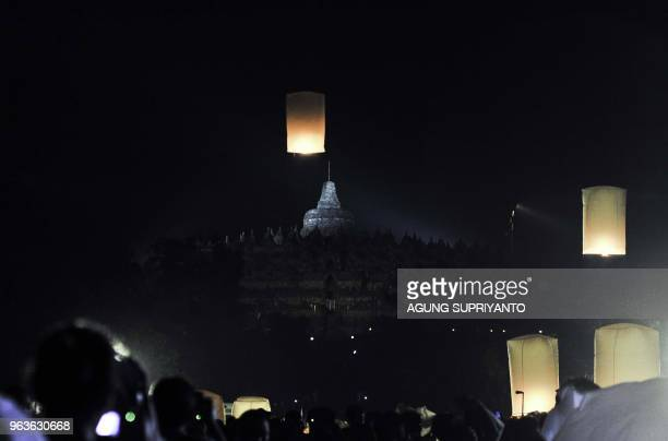 This picture taken on May 29 2018 shows Buddhist monks and devotees releasing lanterns after conducting prayers at the Borobudur temple in Magelang...