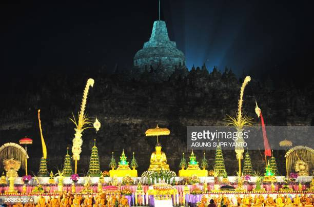 This picture taken on May 29 2018 shows Buddhist monks conducting prayers at the Borobudur temple in Magelang Central Java on Vesak Day Buddhist...