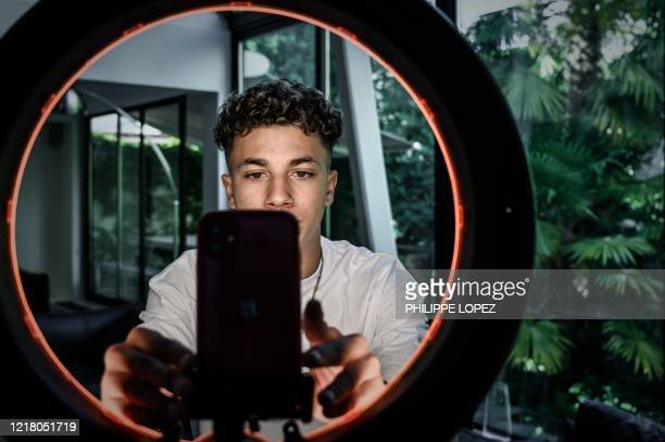This picture taken on May 29, 2020 shows French internet influencer Rafael Caplan @raf_cpl creating content on the video platform Tik Tok at the...