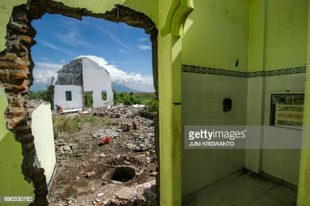 This picture taken on May 30 2017 shows the remains of houses left by residents who received compensation from oil and gas company PT Lapimdo Brantas...