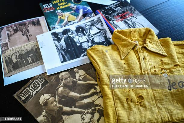 This picture taken on May 30 2019 in Melun shows souvenirs of Tour de France's French cyclist veteran Jacques Marinelli Jacques Marinelli wore the...
