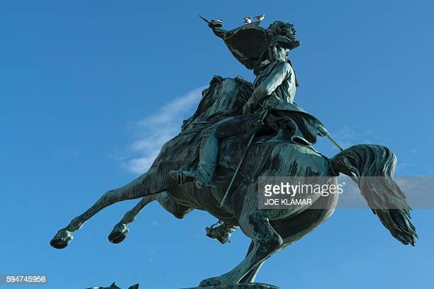 This picture taken on May 31, 2016 in Vienna shows a statue of Archduke Karl in front of the Hofburg Palace at Helden platz. Even a century after his...