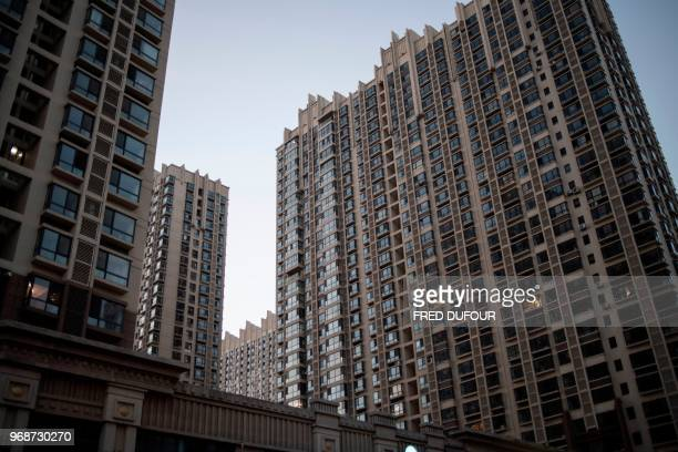 This picture taken on May 31 2018 shows a general view of residential buildings in the border city of Dandong in China's northeast Liaoning province...