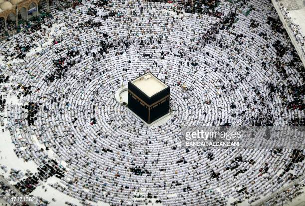 TOPSHOT This picture taken on May 31 2019 from the Mecca Royal Hotel Clock Tower shows an aerial view of Muslim worshippers prostrating during prayer...
