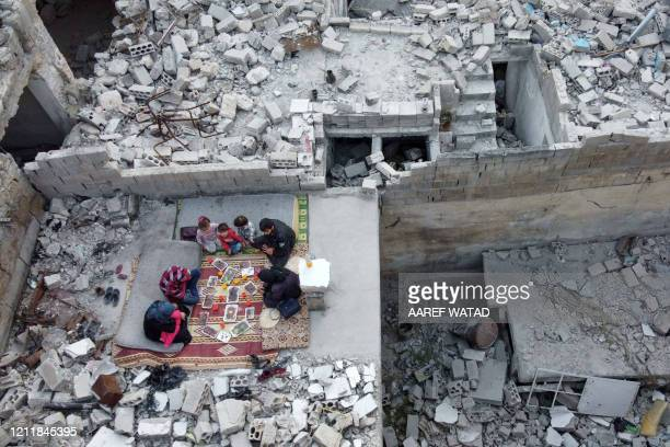 This picture taken on May 4 2020 during the Muslim holy fasting month of Ramadan shows an aerial view of members of the displaced Syrian family of...