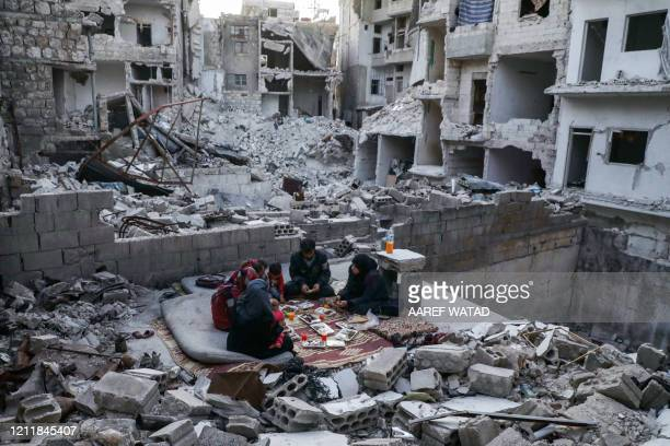 TOPSHOT This picture taken on May 4 2020 during the Muslim holy fasting month of Ramadan shows members of the displaced Syrian family of Tareq Abu...