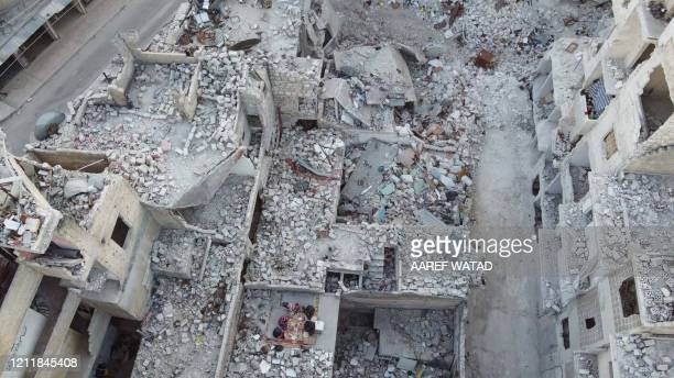 TOPSHOT This picture taken on May 4 2020 during the Muslim holy fasting month of Ramadan shows an aerial view of members of the displaced Syrian...