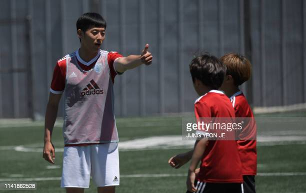 This picture taken on May 6, 2019 shows Son Heung-yun , elder brother of Tottenham Hotspur striker Son Heung-min, gesturing to his students during a...
