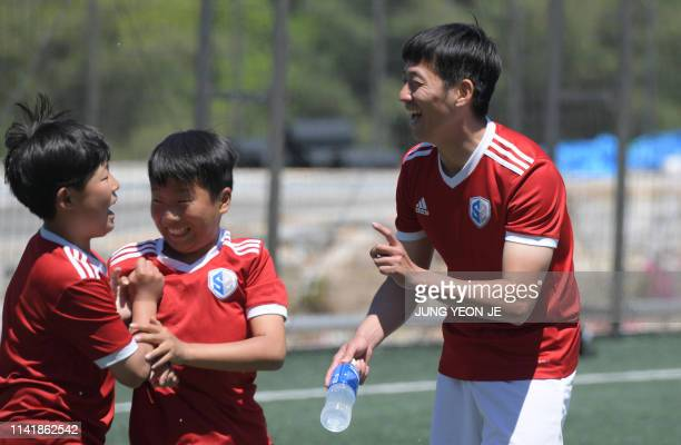 This picture taken on May 6, 2019 shows Son Heung-yun , elder brother of Tottenham Hotspur striker Son Heung-min, smiling with his students during a...