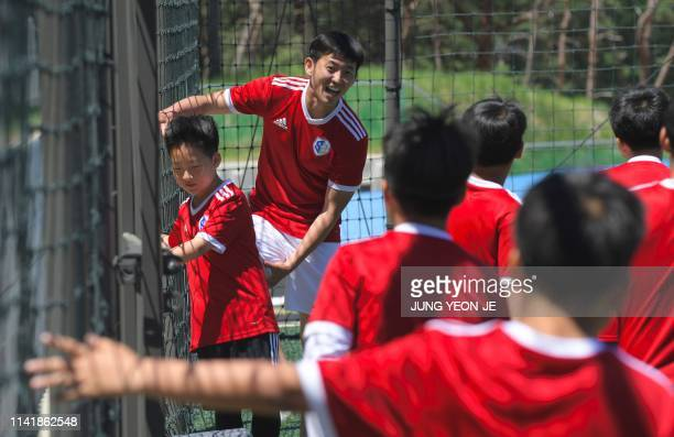 This picture taken on May 6 2019 shows Son Heungyun elder brother of Tottenham Hotspur striker Son Heungmin talking to his students during a training...