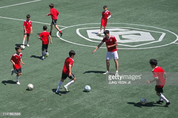 This picture taken on May 6 2019 shows Son Heungyun elder brother of Tottenham Hotspur striker Son Heungmin gesturing to his students during a...