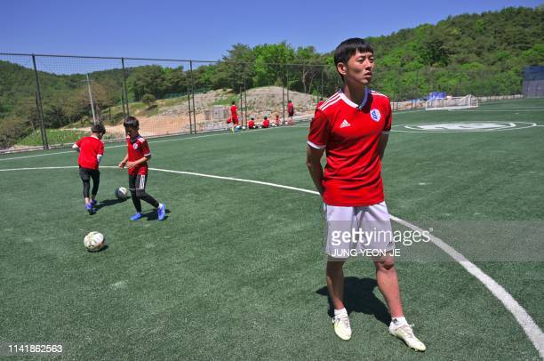 This picture taken on May 6, 2019 shows Son Heung-yun , elder brother of Tottenham Hotspur striker Son Heung-min, speaking during an interview with...