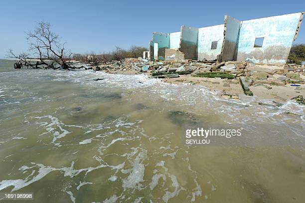 This picture taken on May 7 2013 in the village of Doun Baba Diye near SaintLouis northern Senegal shows the ruins of houses destroyed by the rise of...