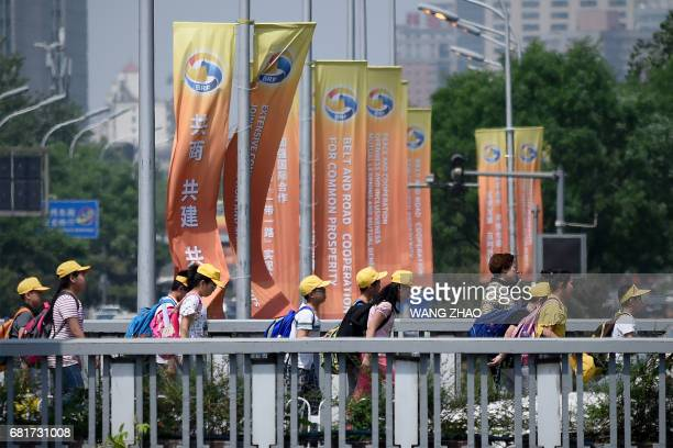 This picture taken on May 9 2017 shows a group of pupils walking on a overpass ahead of the Belt and Road Forum for International Cooperation in...
