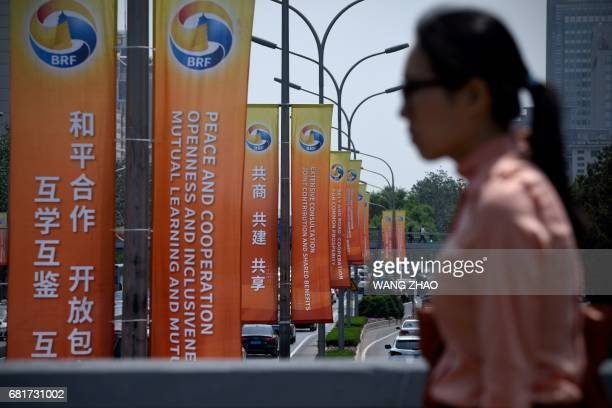 This picture taken on May 9 2017 shows banners displayed along a street ahead of the Belt and Road Forum for International Cooperation in Beijing...
