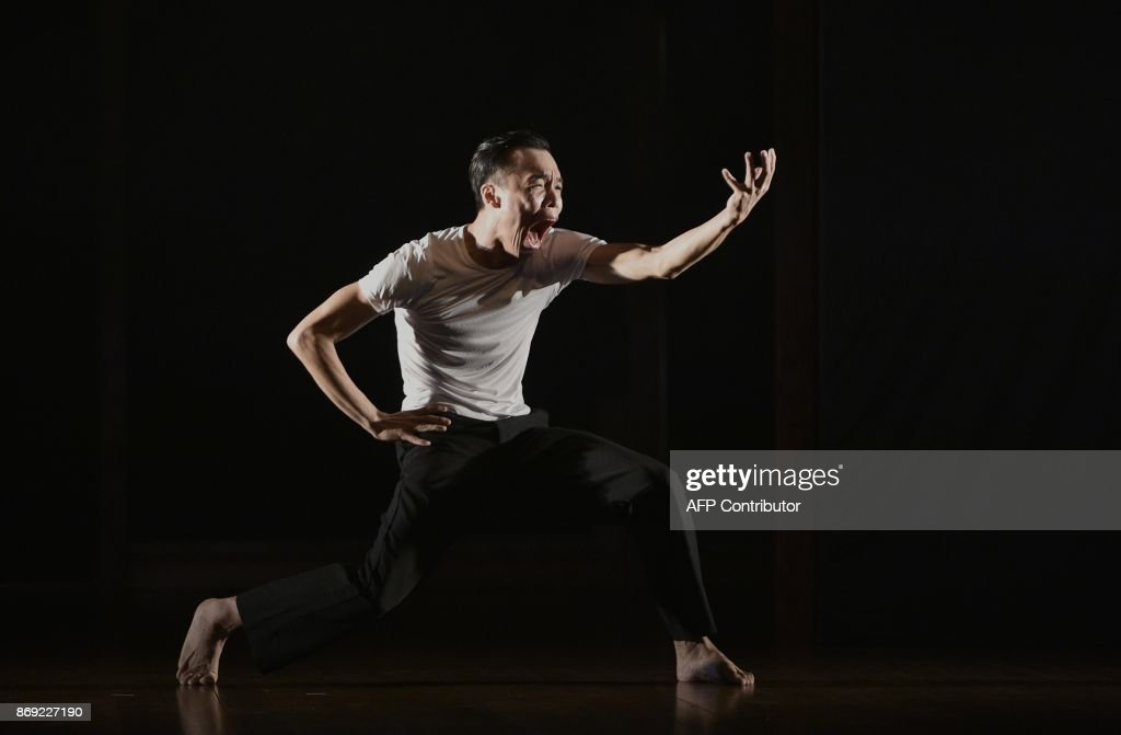This picture taken on November 1, 2017 shows a dancer performing during a rehearsal for Taiwan's Tsai Jui-yuah Dance Festival in Taipei. Often touching on political themes, from human rights to land issues, this year's festival reflects the 70th anniversary of a purge of opponents by nationalist Chinese troops, led by the island's former authoritarian ruler Chiang Kai-shek. /