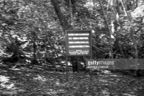 This picture taken on November 1 2018 shows a suicide warning board at the entrance of Aokigahara Forest known as Suicide Forest in Narusawa village...