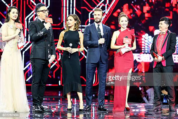 This picture taken on November 10 2016 shows Britain's David Beckham and his wife Victoria Beckham attending the 2016 Tmall 1111 Global Shopping...