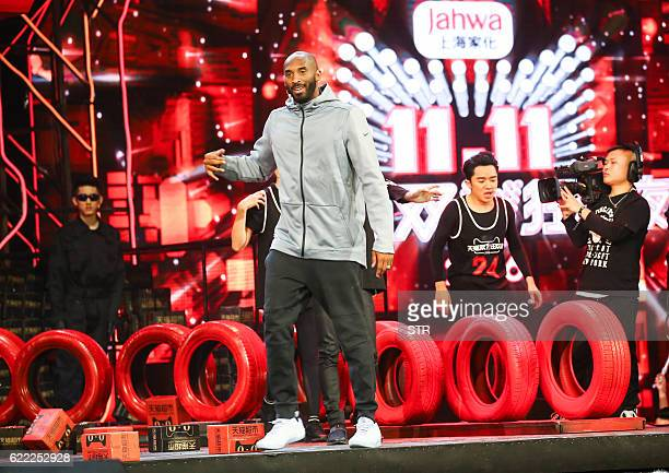 This picture taken on November 10 2016 shows former Los Angeles Laker Kobe Bryant performing during the 2016 Tmall 1111 Global Shopping Festival gala...