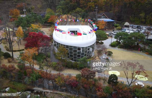 This picture taken on November 10 2017 shows a steel and glass toiletshaped house Haewoojae Museum in Suwon south of Seoul South Korean sanitation...
