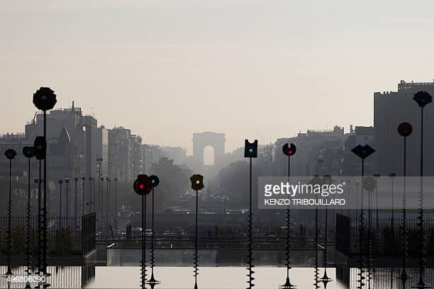 This picture taken on November 12 2015 shows La Defense business district suburban Paris and the Arc de Triomphe AFP PHOTO / KENZO TRIBOUILLARD