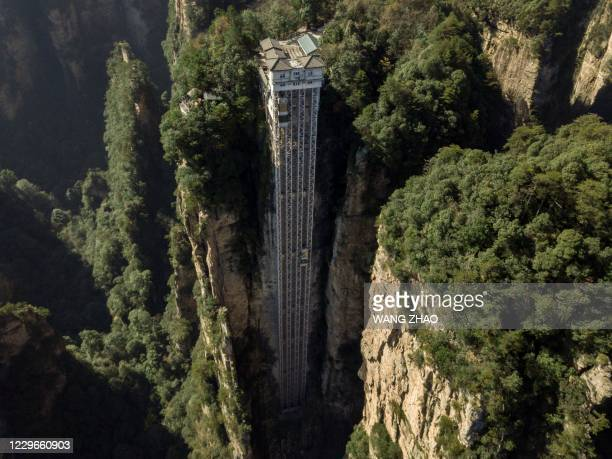 This picture taken on November 13, 2020 shows shows an aerial view of the Bailong elevators in Zhangjiajie, China's Hunan province. - Towering more...
