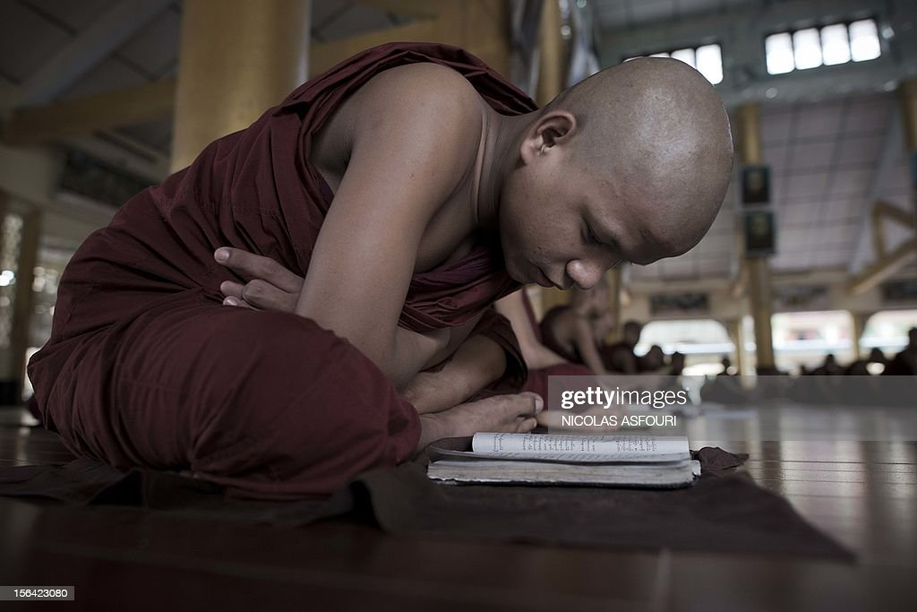 This picture taken on November 14, 2012 shows a novice Buddhist monk studying at the Kyat Khat Wine monastery in Bago. Myanmar's government has said it 'warmly welcomes' the historic visit of President Barack Obama later this month, expressing hope his trip will bolster the nation's political reform drive. AFP PHOTO/ Nicolas ASFOURI