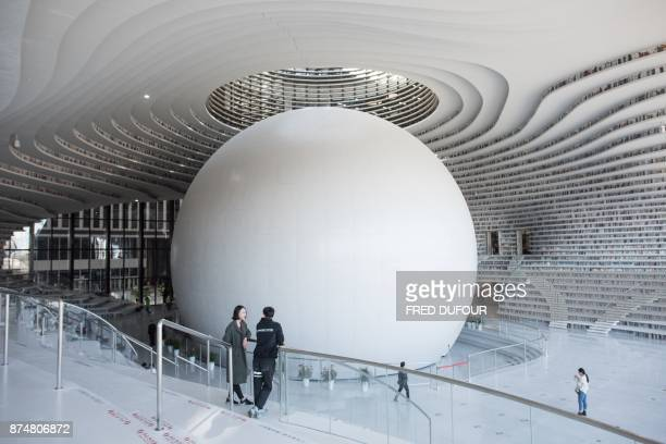 This picture taken on November 14 2017 shows a general view of the Tianjin Binhai Library A futuristic Chinese library has wowed book lovers around...