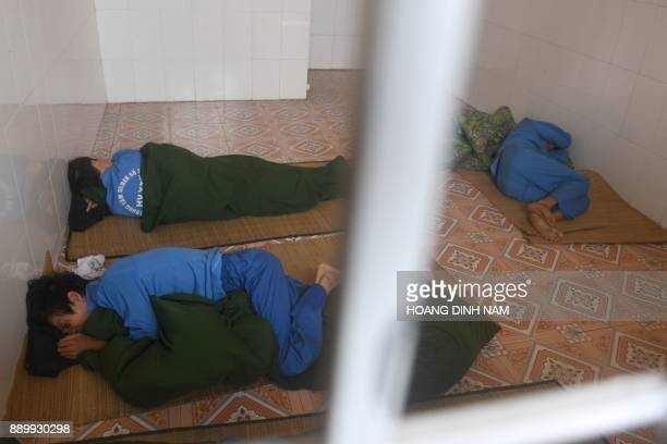 This picture taken on November 16 2017 shows inmates lying on the floor of a locked room where they are subjected to an initial period of cold turkey...