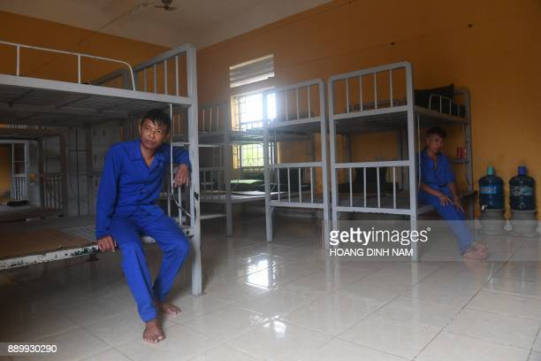 This picture taken on November 16 2017 shows inmates sitting on thier bunk beds in a dormitory before lunchtime inside a drug rehabilitation centre...