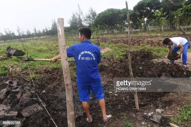 This picture taken on November 16 2017 shows inmates working on agricultural land at a drug rehabilitation centre in the northern city of Hai Phong...