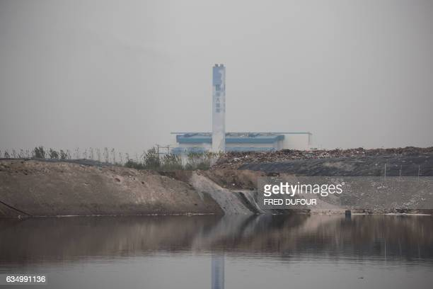 This picture taken on November 17 2015 shows the local incinerator in Gaojia in China's Shandong province on November 17 2015 AFP PHOTO / FRED DUFOUR...